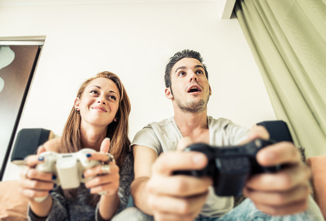 A couple playing video games.
