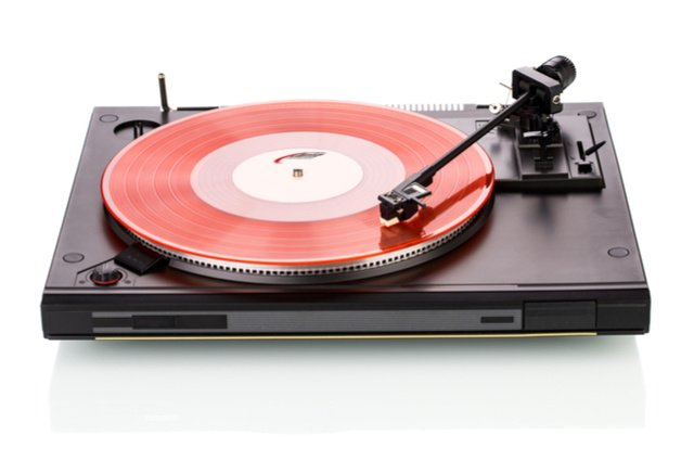Industrial cleaning songs record player image by Indigolotos (via Shutterstock).